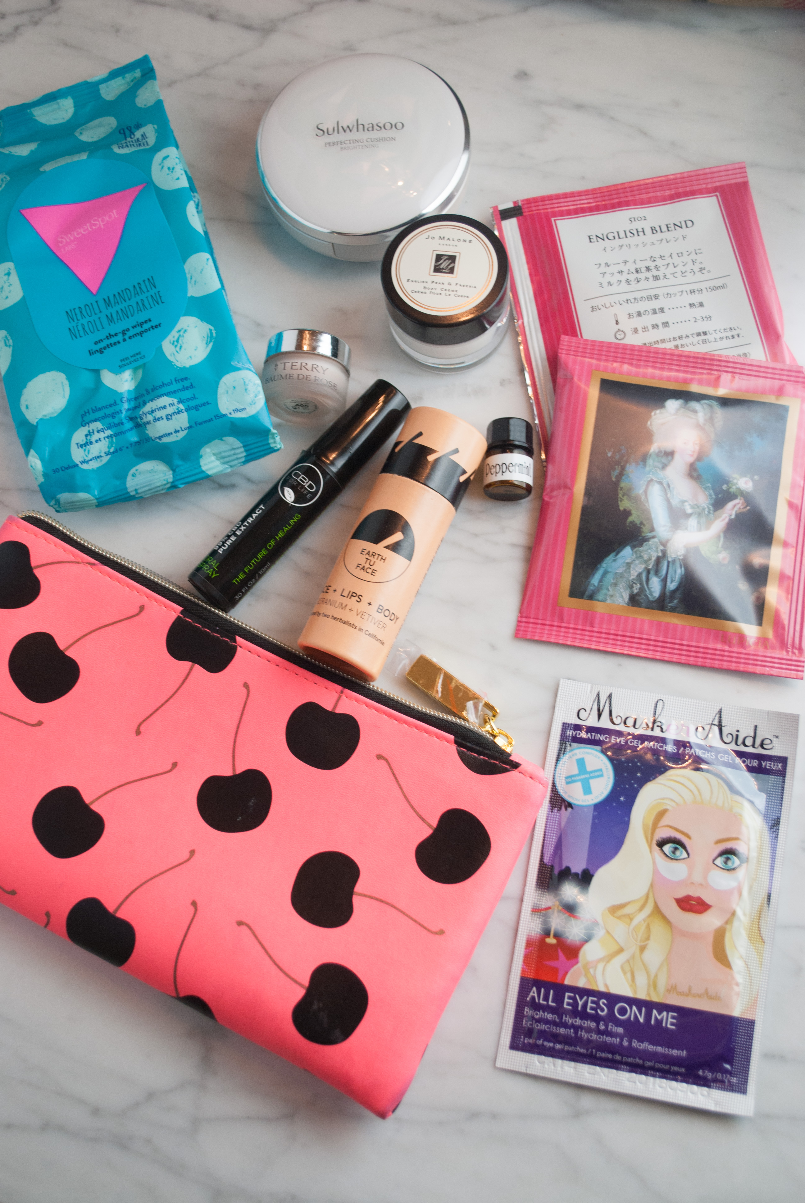 My Favorite Carry On Essentials featured by popular California beauty blogger, Haute Beauty Guide