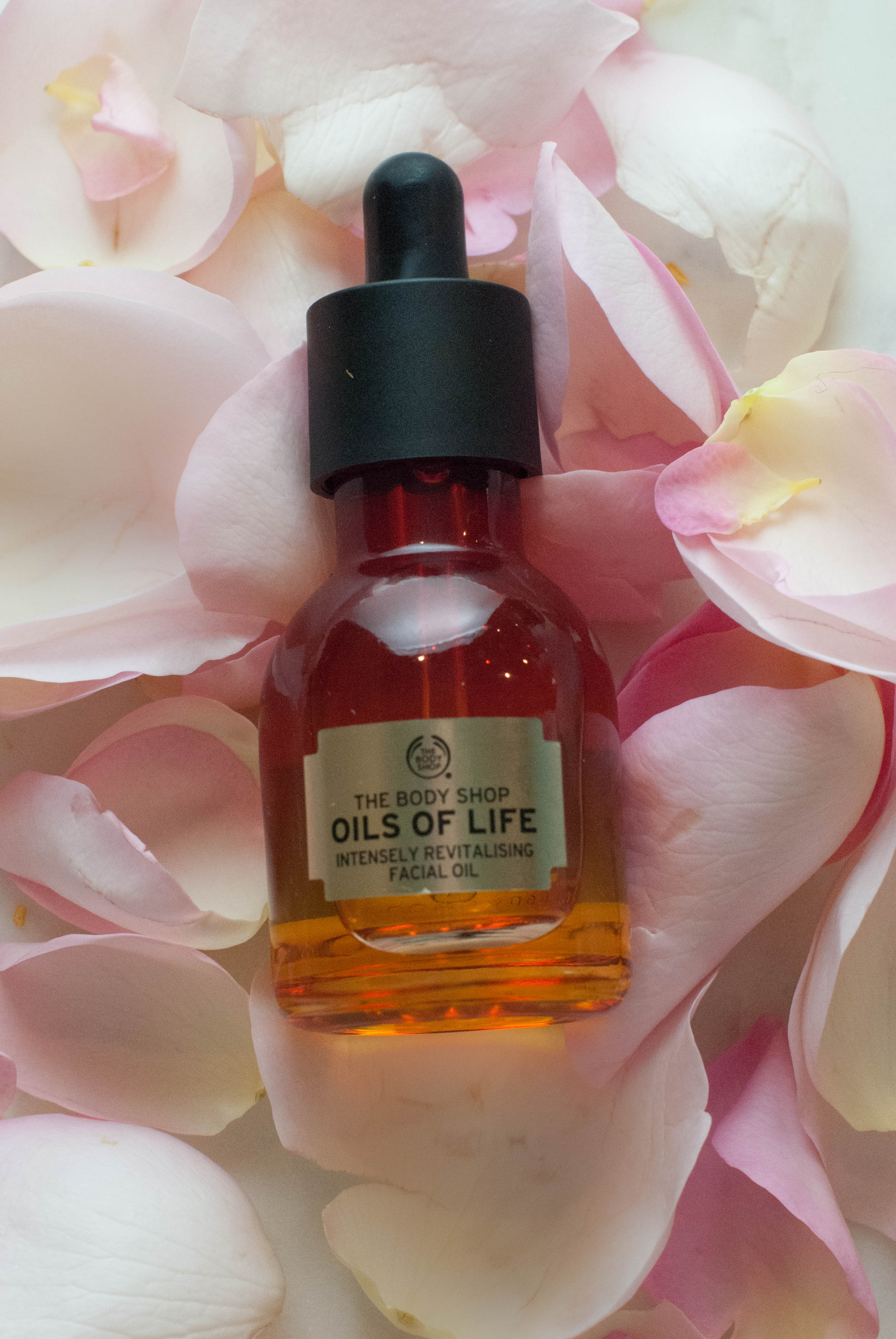 My Five favorite facial oils and how to use them. The Body Shop Oils of Life Instensely Revitalizing facial oil - The 5 Best Face Oils  featured by popular California beauty blogger, Haute Beauty Guide