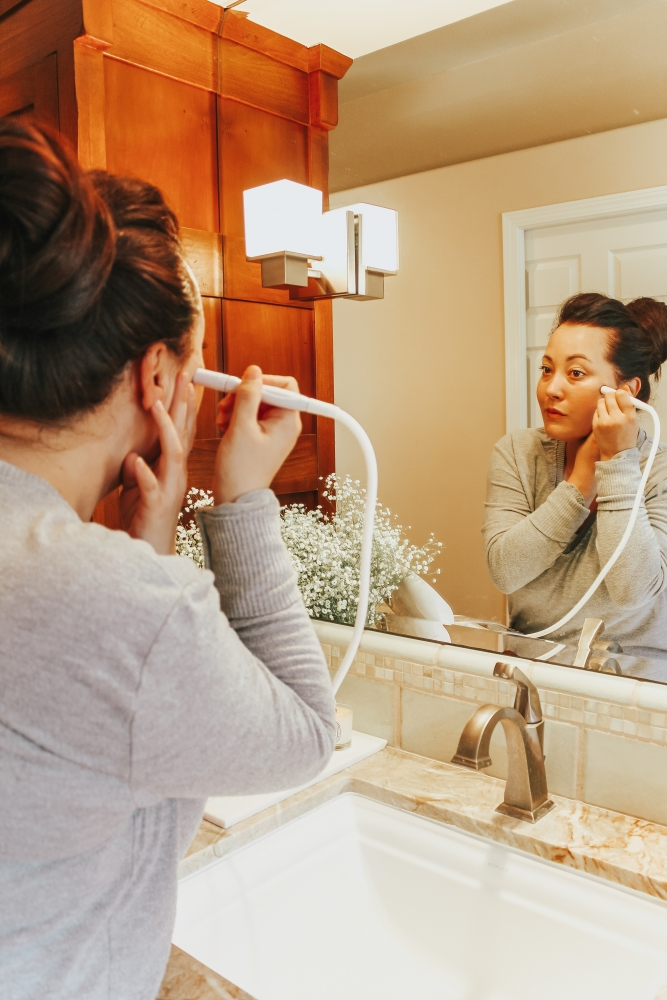 Skin Care Trends featured by top US beauty blog Haute Beauty Guide; Image of a woman cleaning her face.