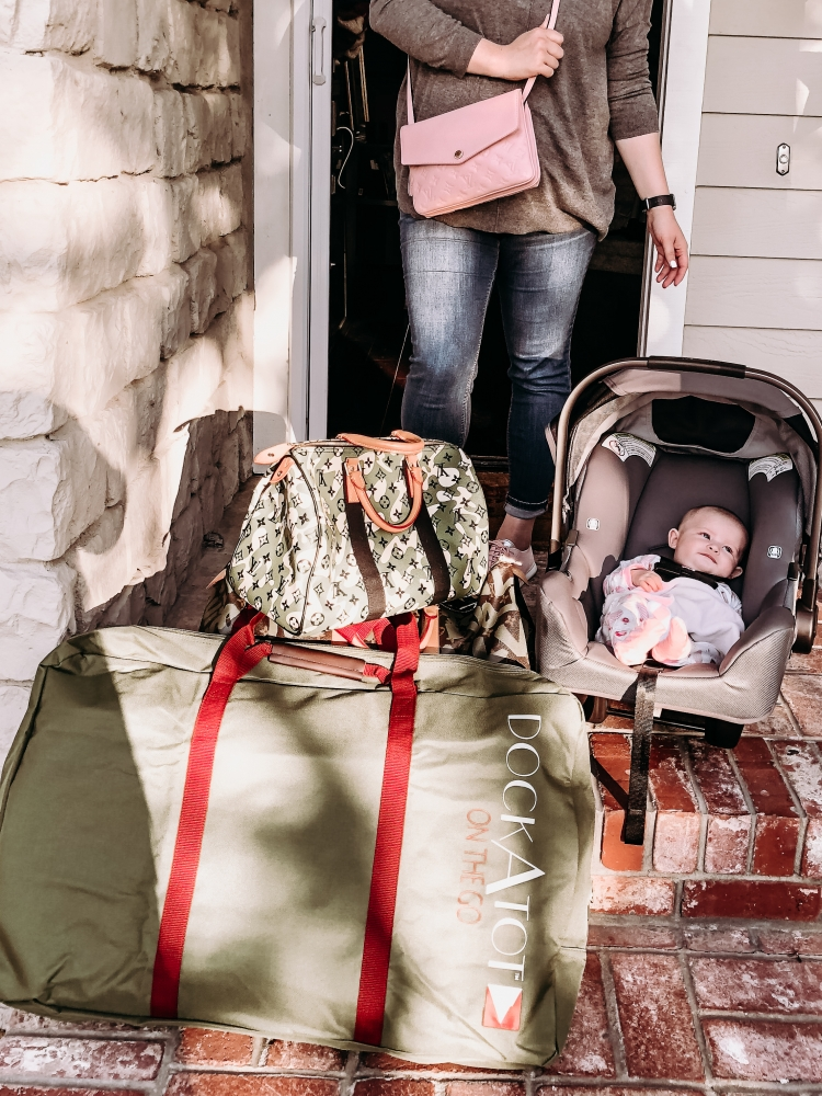 Dock-A-Tot Review: Traveling with Baby Made Easy featured by popular California mom blogger Haute Beauty Guide