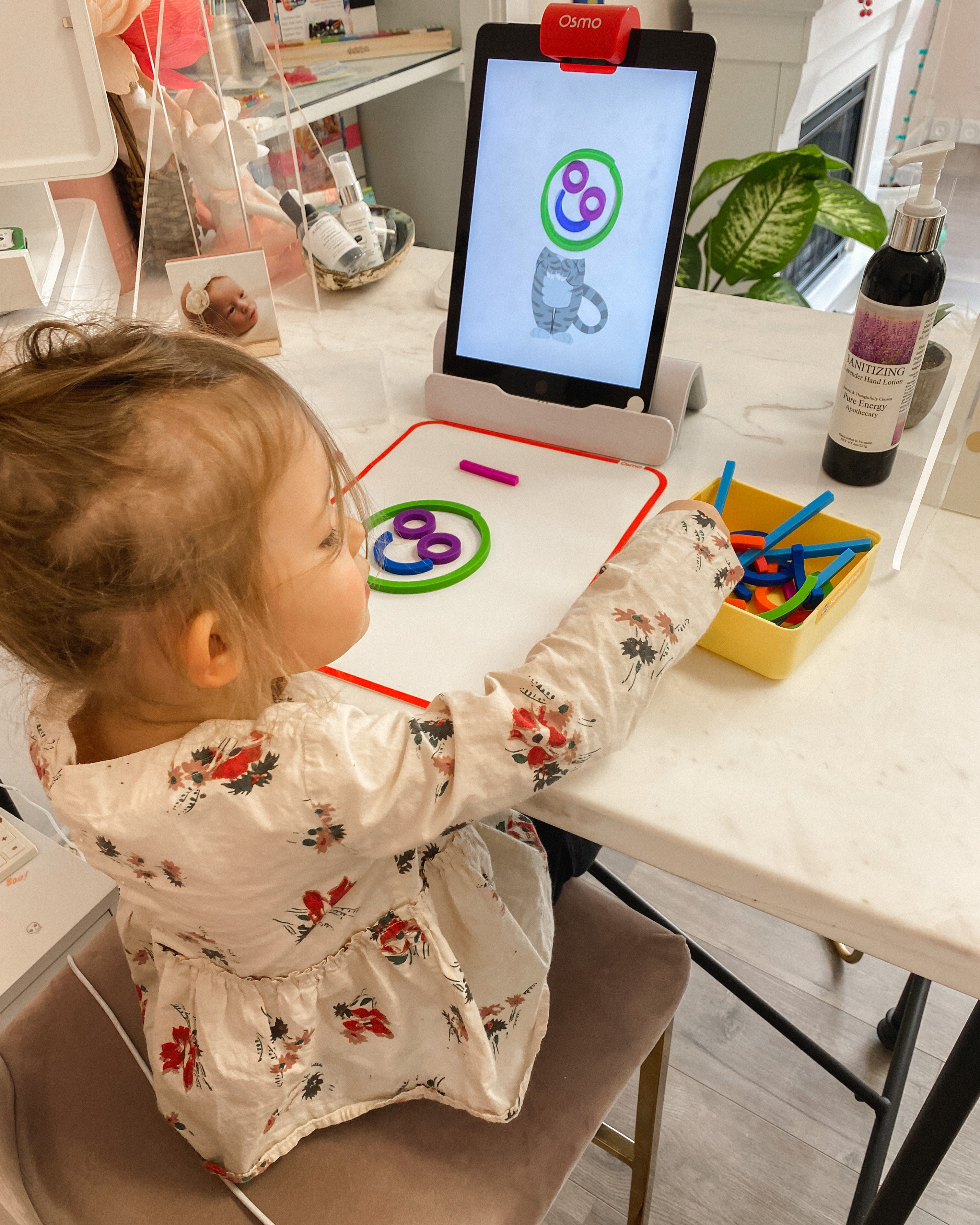 Baby Black Friday Deals by popular Monterey motherhood blog, Haute Beauty Guide: image of a little girl using Osmo.
