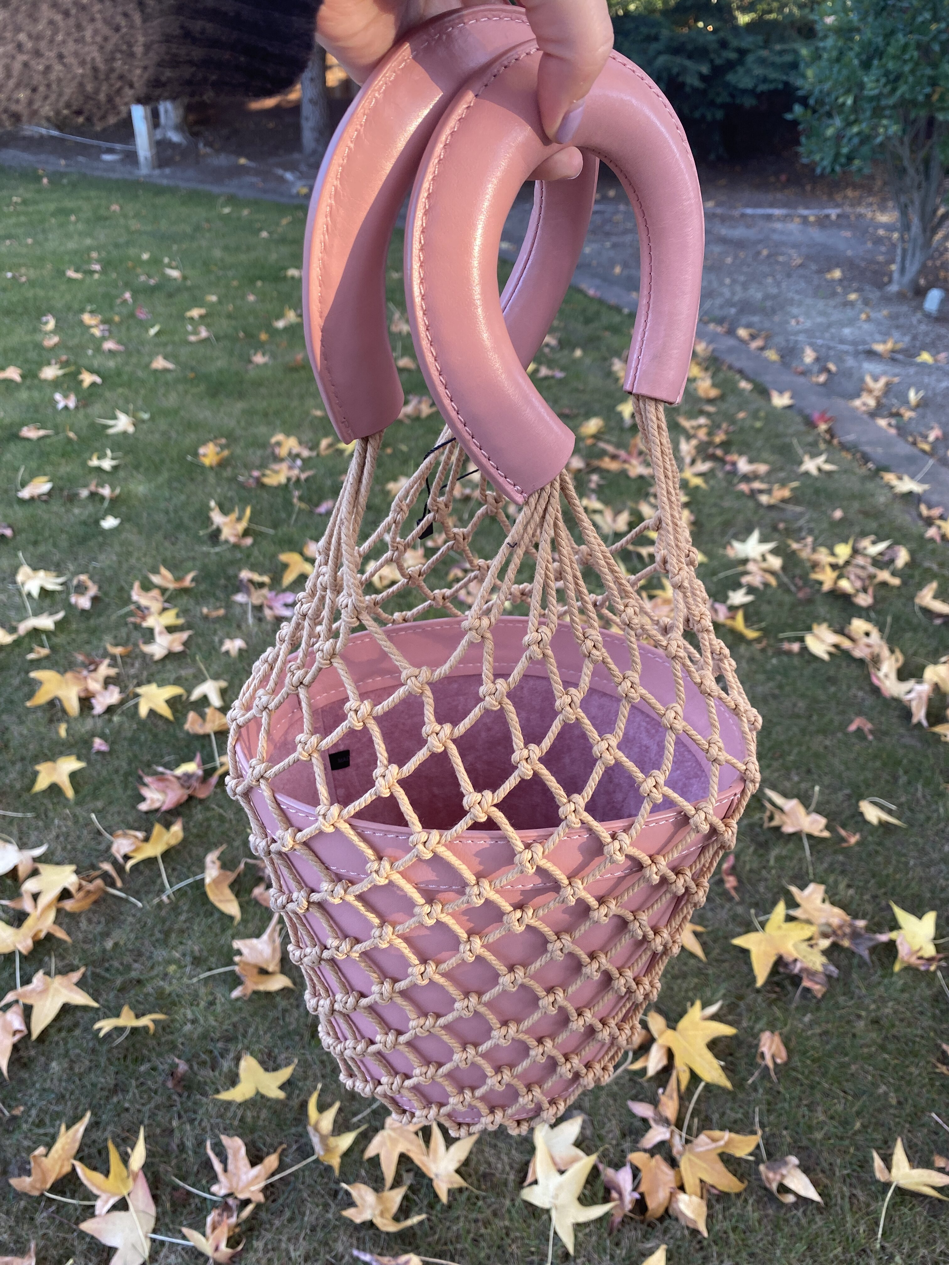 California Fashion by popular Monterey fashion blog, Haute Beauty Guide: image of a woman holding a bucket purse.