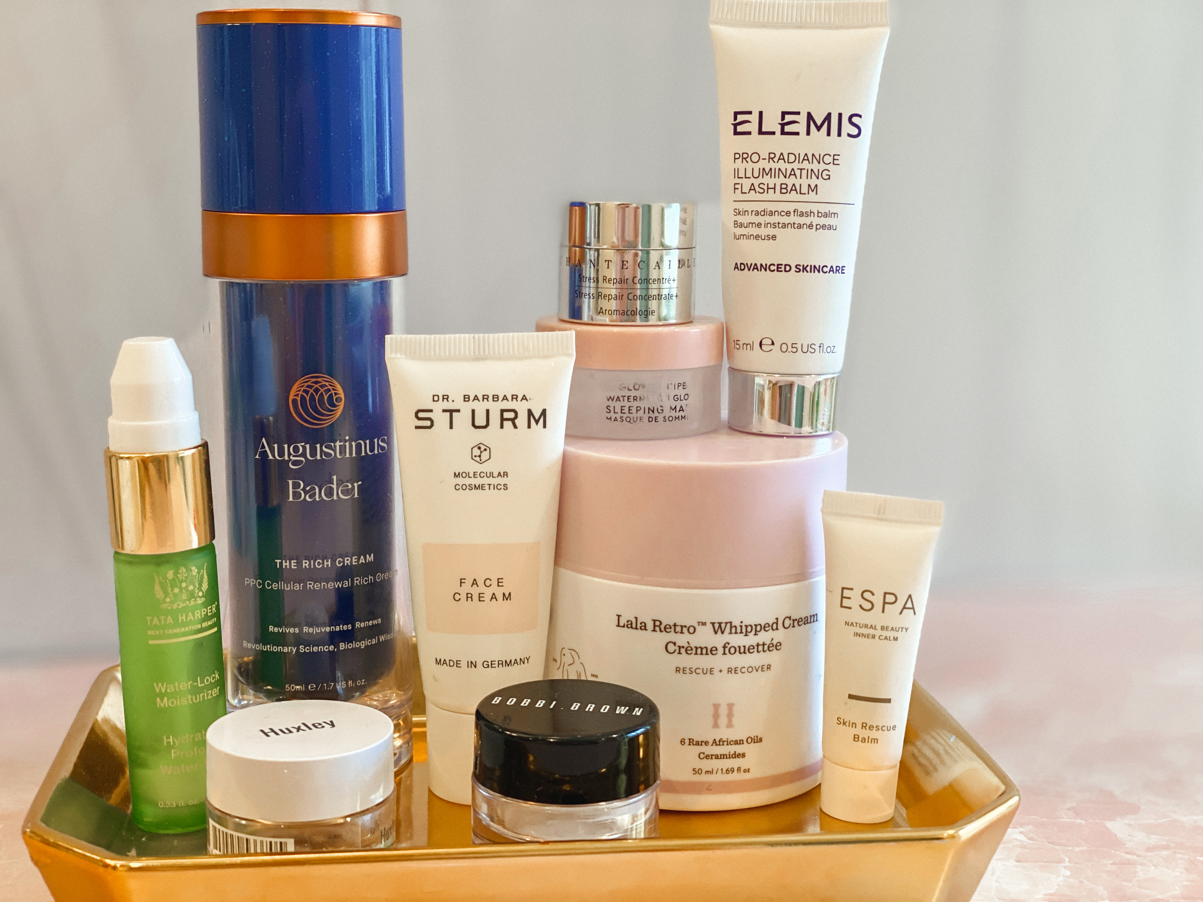 Winter Skincare by popular Monterey beauty blog, Haute Beauty Guide: image of Elemis, Augstinus Bader, Dr. Barbara Strum, Lala Retro whipped cream, and Bobbi Brown beauty products.