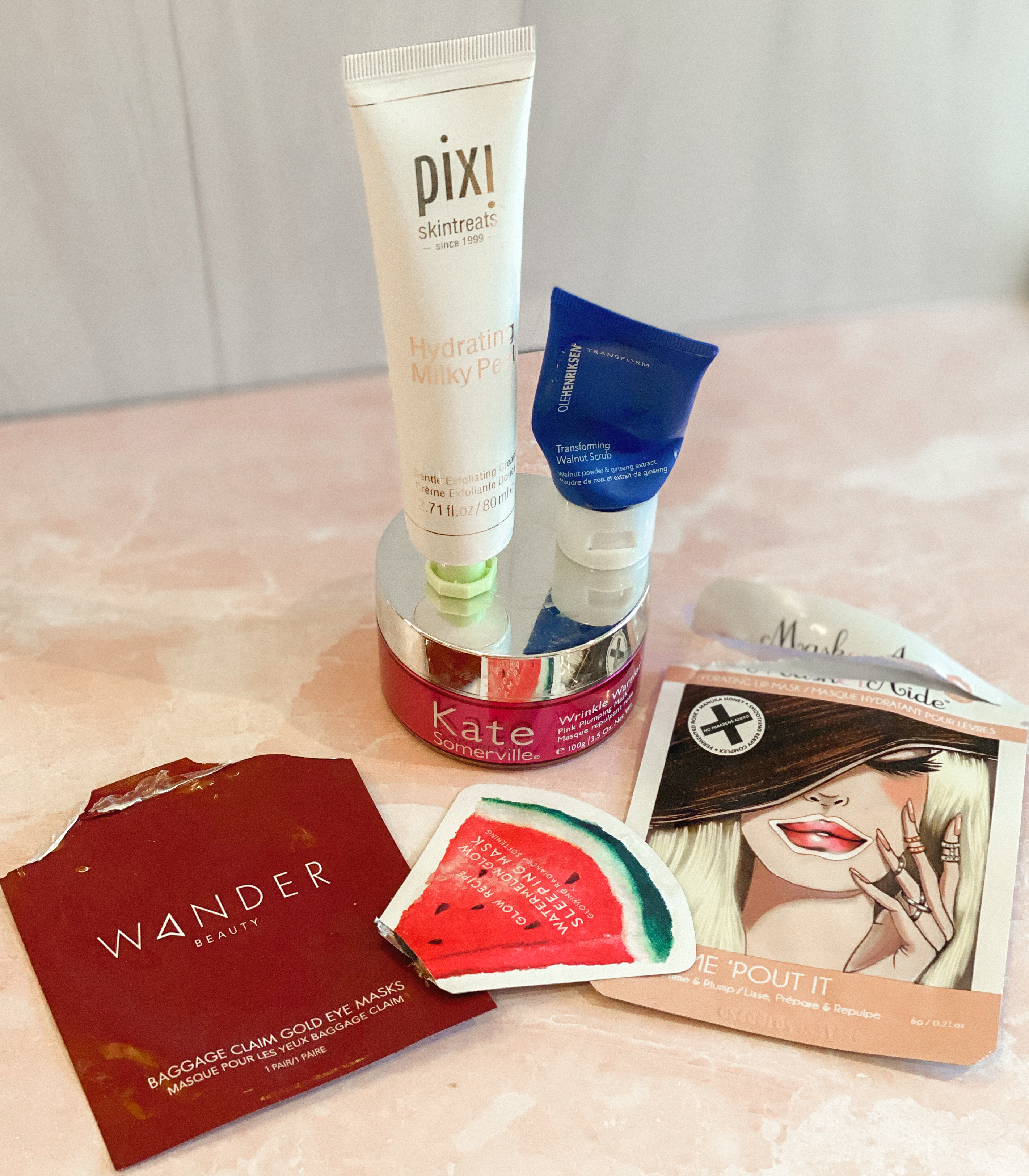 Winter Skincare by popular Monterey beauty blog, Haute Beauty Guide: image of Pixi Skintreats and various face mask sheets.