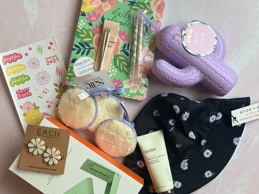 Spring FabFitFun Box by popular Monterey life and style blog, Haute Beauty Guide: image of Each Jewels flower hair clips, AHAVA refreshing cleansing gelt, Daisy print bucket hat, rose tweezers and scrub pads.