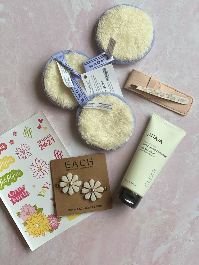 Spring FabFitFun Box by popular Monterey life and style blog, Haute Beauty Guide: image of Each Jewels flower hair clips, AHAVA refreshing cleansing gelt, rose tweezers and scrub pads.