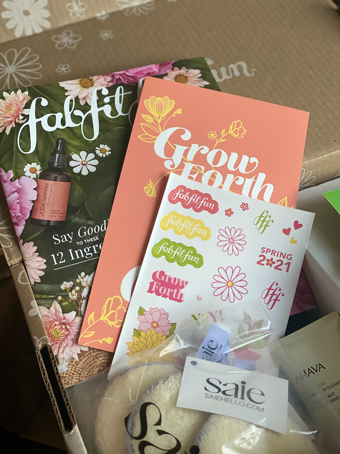 Spring FabFitFun Box by popular Monterey life and style blog, Haute Beauty Guide: image of a fabfitfun box filled with a funfitfab catalogue, stickers, and Saie products.