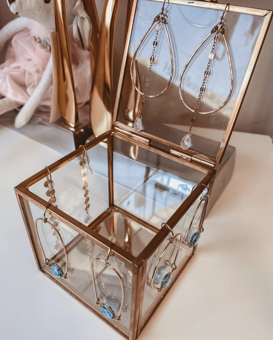 HBG Monterey by popular Monterey fashion blog, Haute Beauty Guide: image of HBG Monterey jewelry in a brass and glass jewelry box.