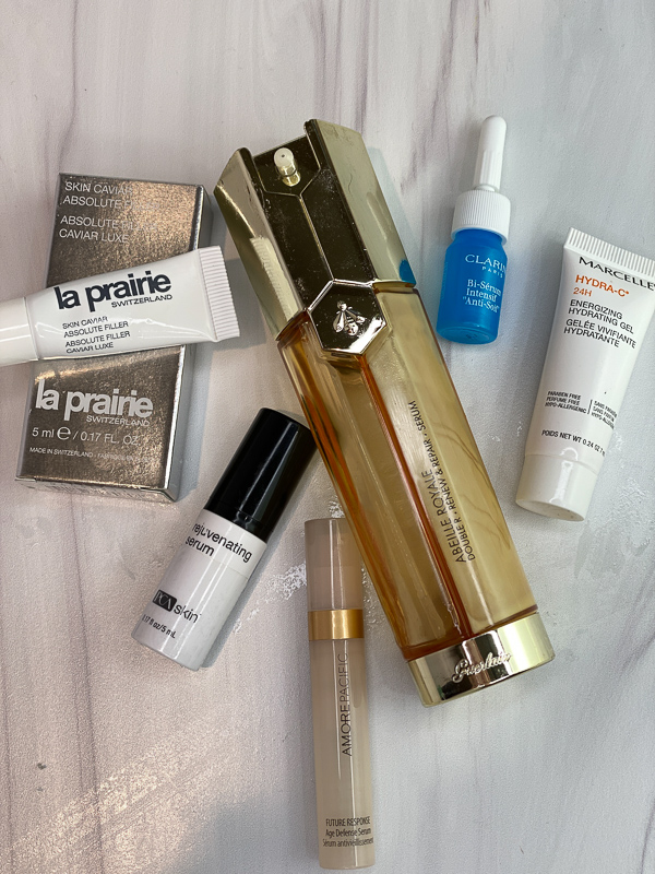 January Empties by popular Monterey beauty blog, Haute Beauty Guide: image of la prairie skin caviar, Abeille Royale serum, Clarins Paris bi serum, Marcelle Hydra-C+, and Amore Pacific.