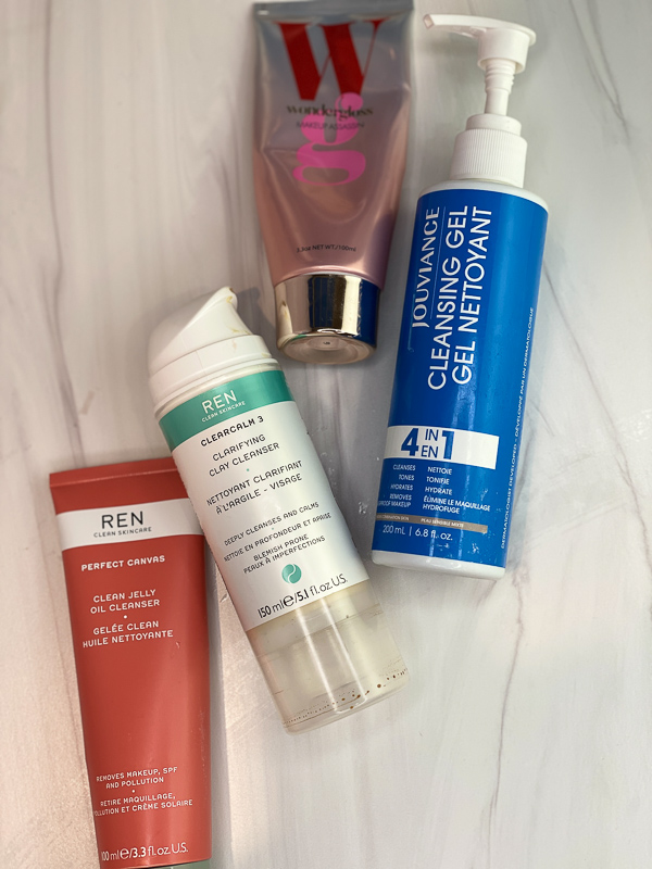 January Empties by popular Monterey beauty blog, Haute Beauty Guide: image of Ren clean skincare clean jelly, Ren clean skincare clarifying clay cleanser, and Jouvance cleansing gel nettoyant.
