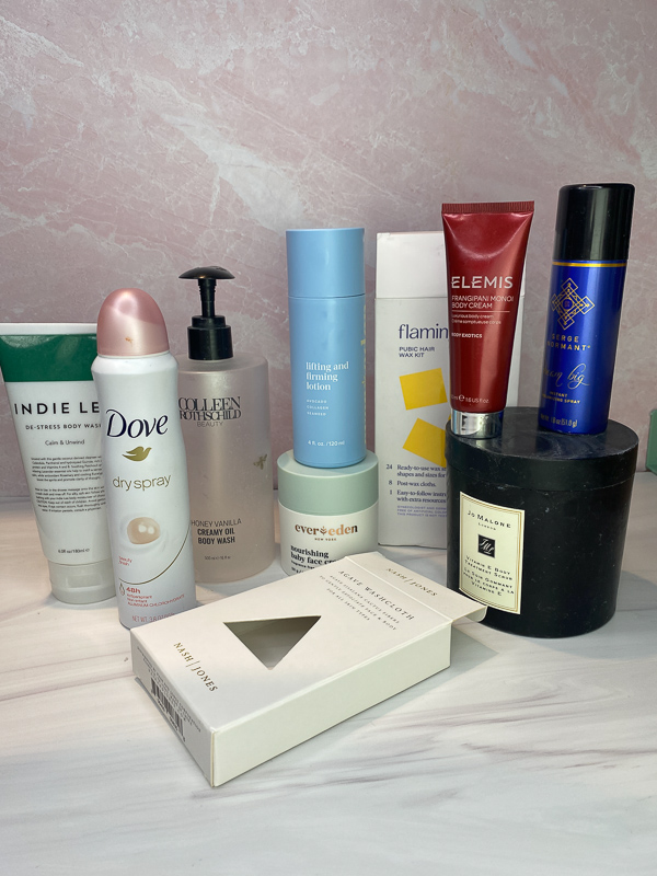January Empties by popular Monterey beauty blog, Haute Beauty Guide: image of Dove dry spray, Colleen Rothschild creamy oil body wash Indie Lee body wash, Elemis fragrance body cream, and Ever Eden moisturizing baby face cream.