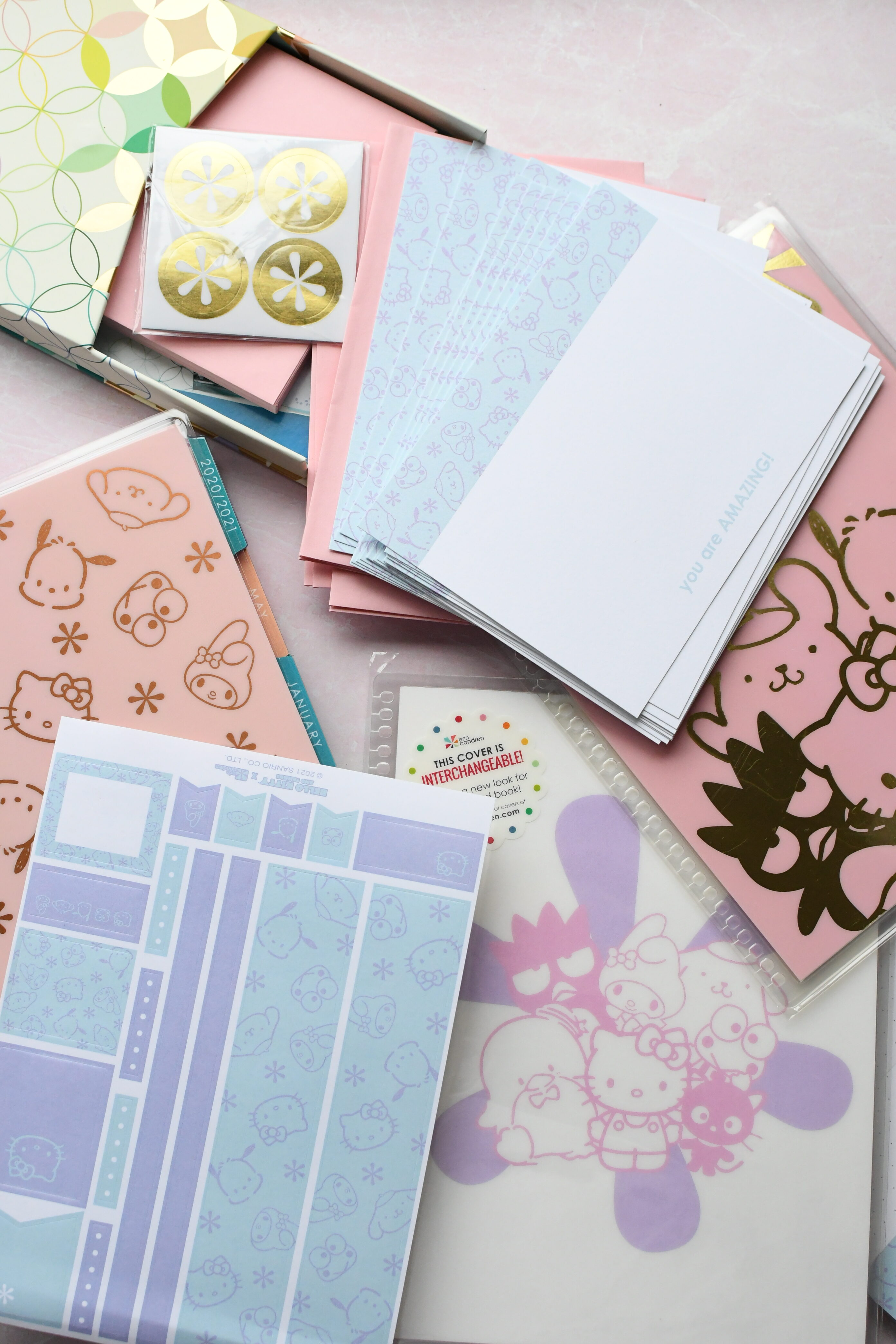 Erin Condrin Hello Kitty Collection by popular Monterey lifestyle blog, Haute Beauty Guide: image of a Hello Kitty planner collection.
