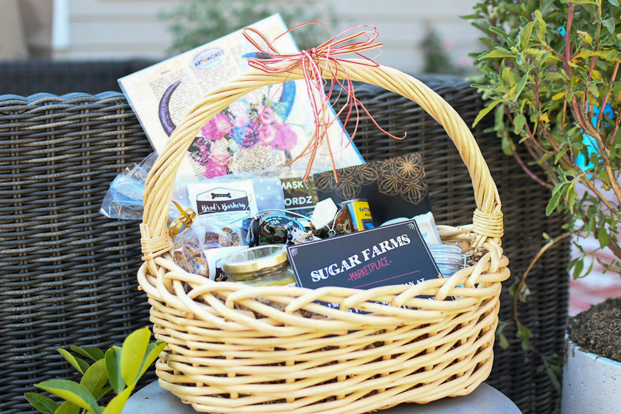 Carmel Plaza by popular Monterey lifestyle blog, Haute Beauty Guide: image of a basket filled with Sugar Farms Marketplace food items.