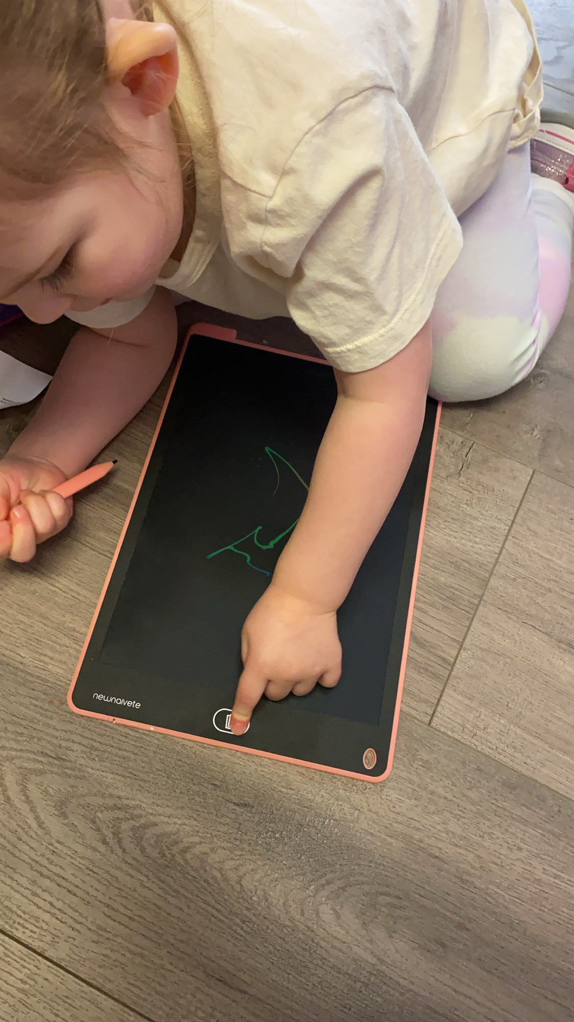 Toddler Homeschool by popular Monterey motherhood blog, Haute Beauty Guide: image of a little girl using a writing tablet.