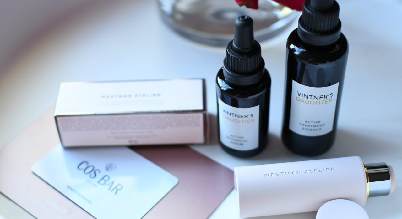 Carmel Plaza by popular Monterey lifestyle blog, Haute Beauty Guide: image of a Cos Bar gift card and Vintner's Daughter face serum.
