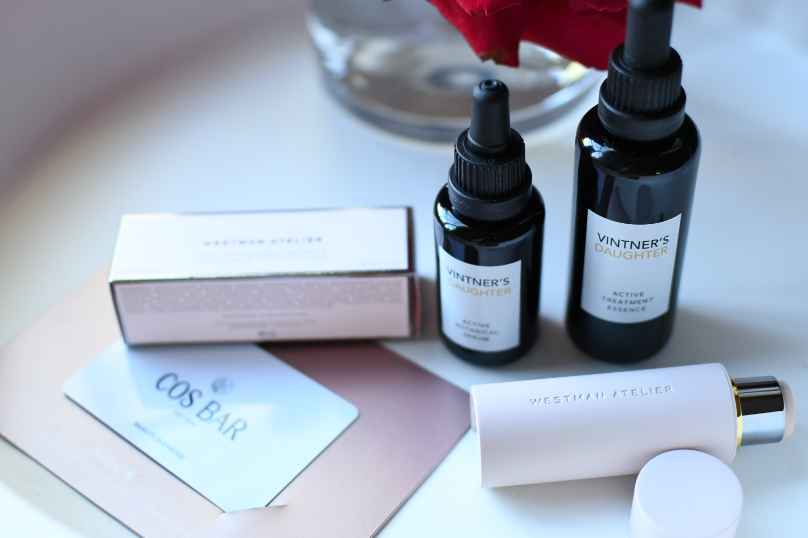 Cos Bar Sale by popular Monterey beauty blog, Haute Beauty Guide: image of a Cos Bar gift card and Vintner's Daughter active treatment.