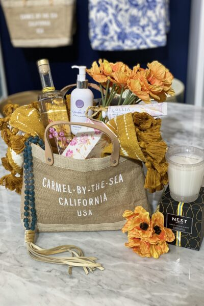 Carmel Plaza by popular Monterey lifestyle blog, Haute Beauty Guide: image of beauty supplies in a Carmel-by-the-sea tote bag.