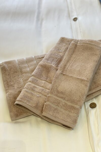 Carmel Plaza by popular Monterey lifestyle blog, Haute Beauty Guide: image of tan towels.