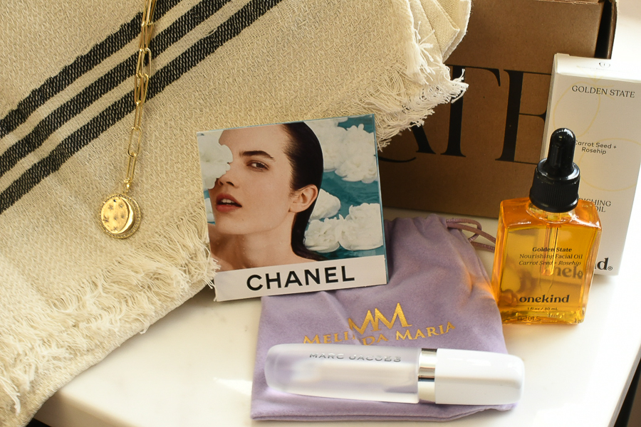 Curateur Summer 2021 Box by popular Monterey life and style blog, Haute Beauty Guide: image of Curateur box next to a bottle of onekind Golden State facial oil, Marc Jacobs roll Ono perfume, and gold pendant necklace.