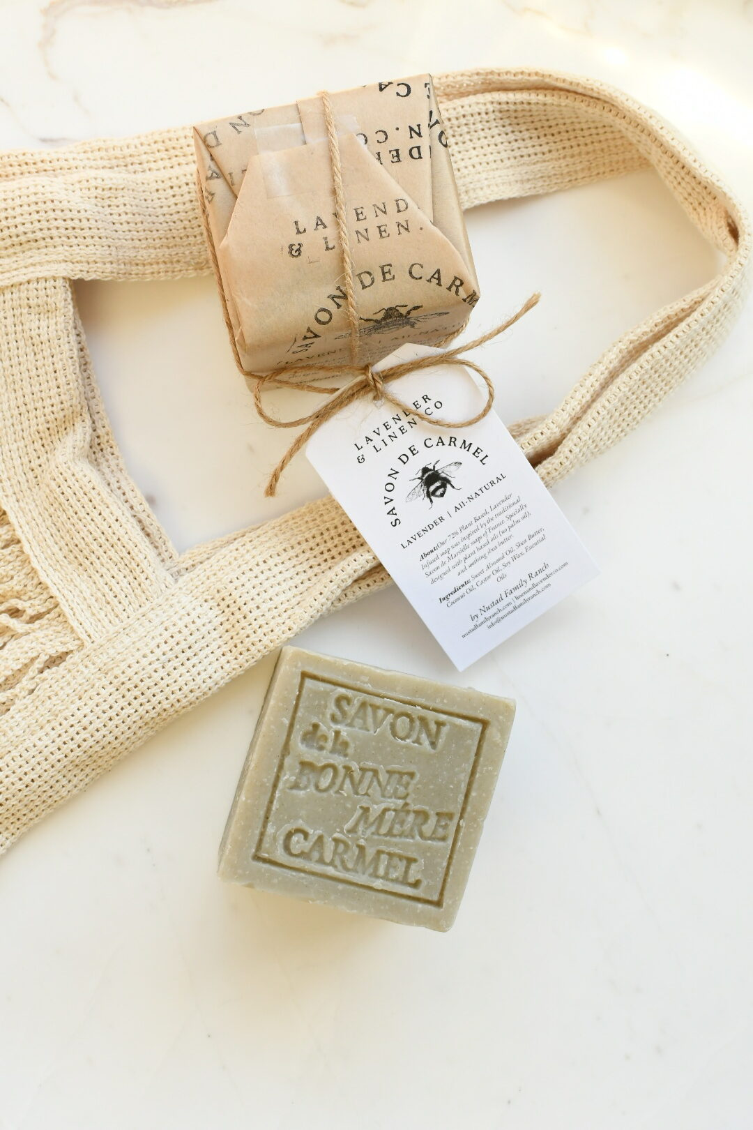 California Products by popular Monterey life and style blog, Haute Beauty Guide: image of Salon de Carmel soap next to a mesh shopping bag.