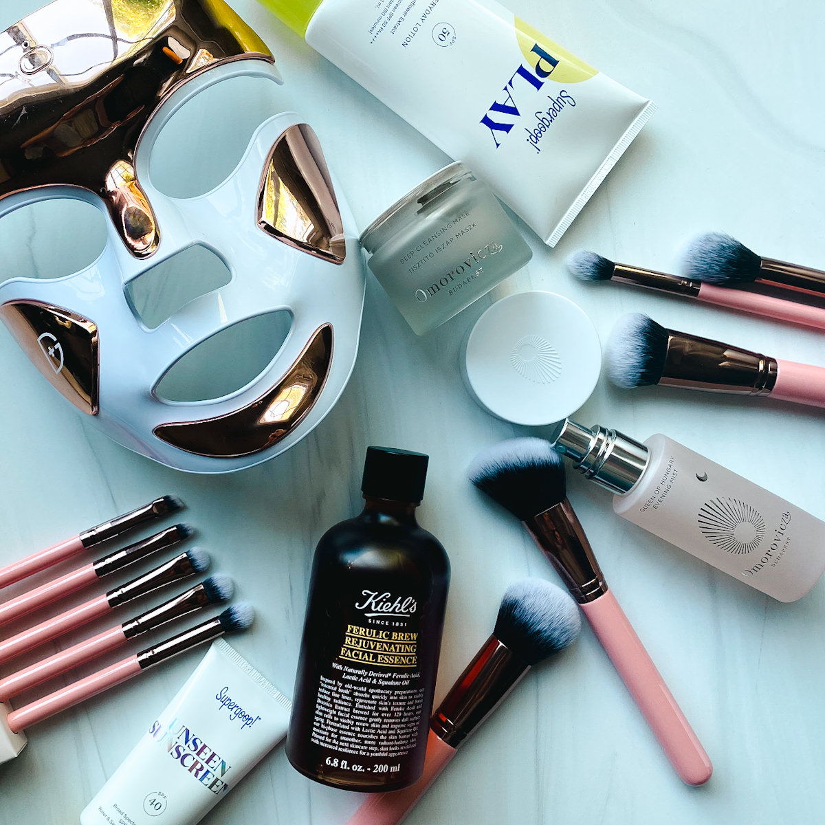 Nordstrom Anniversary Sale by popular Monterey beauty blog, Haute Beauty Guide: image of a light therapy mask, Supergoop! Play sunscreen, makeup brushes, Omorovicza deep cleaning mask, Omorovicza evening mist, and Kiehl's ferulic rejuvenating facial essence.