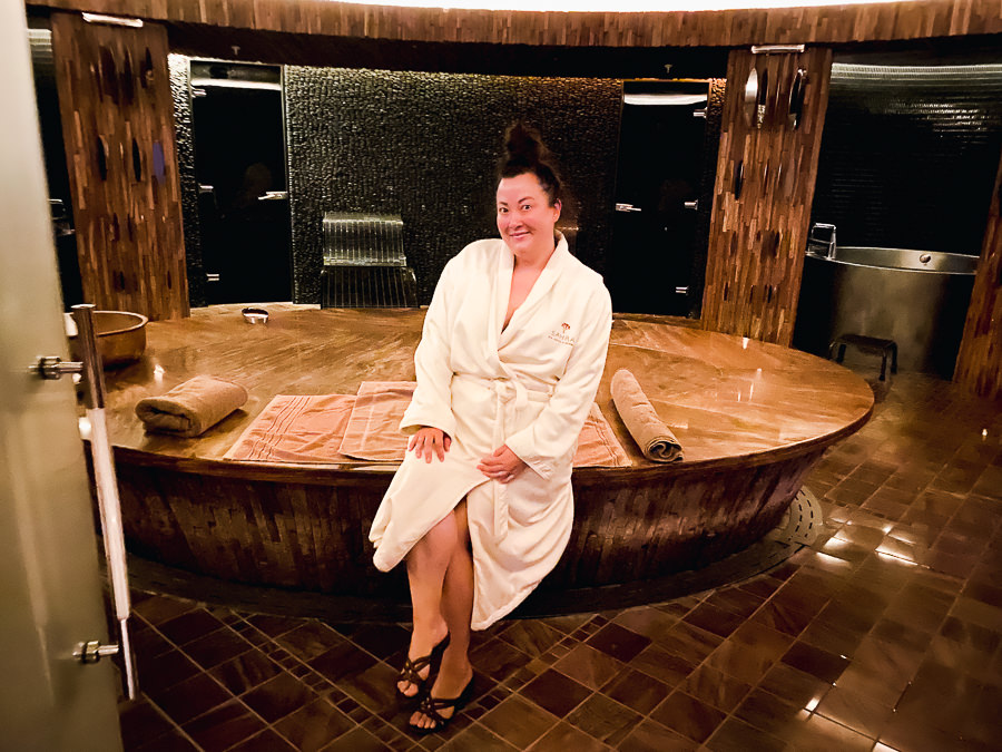 Las Vegas Trip by popular Monterey travel blog, Haute Beauty Blog: image of a woman wearing a white robe at the Red Flower Hammam Experience.