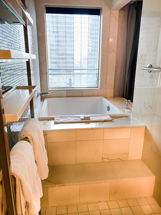 Las Vegas Trip by popular Monterey travel blog, Haute Beauty Blog: image of a square soaking tub next to a window.